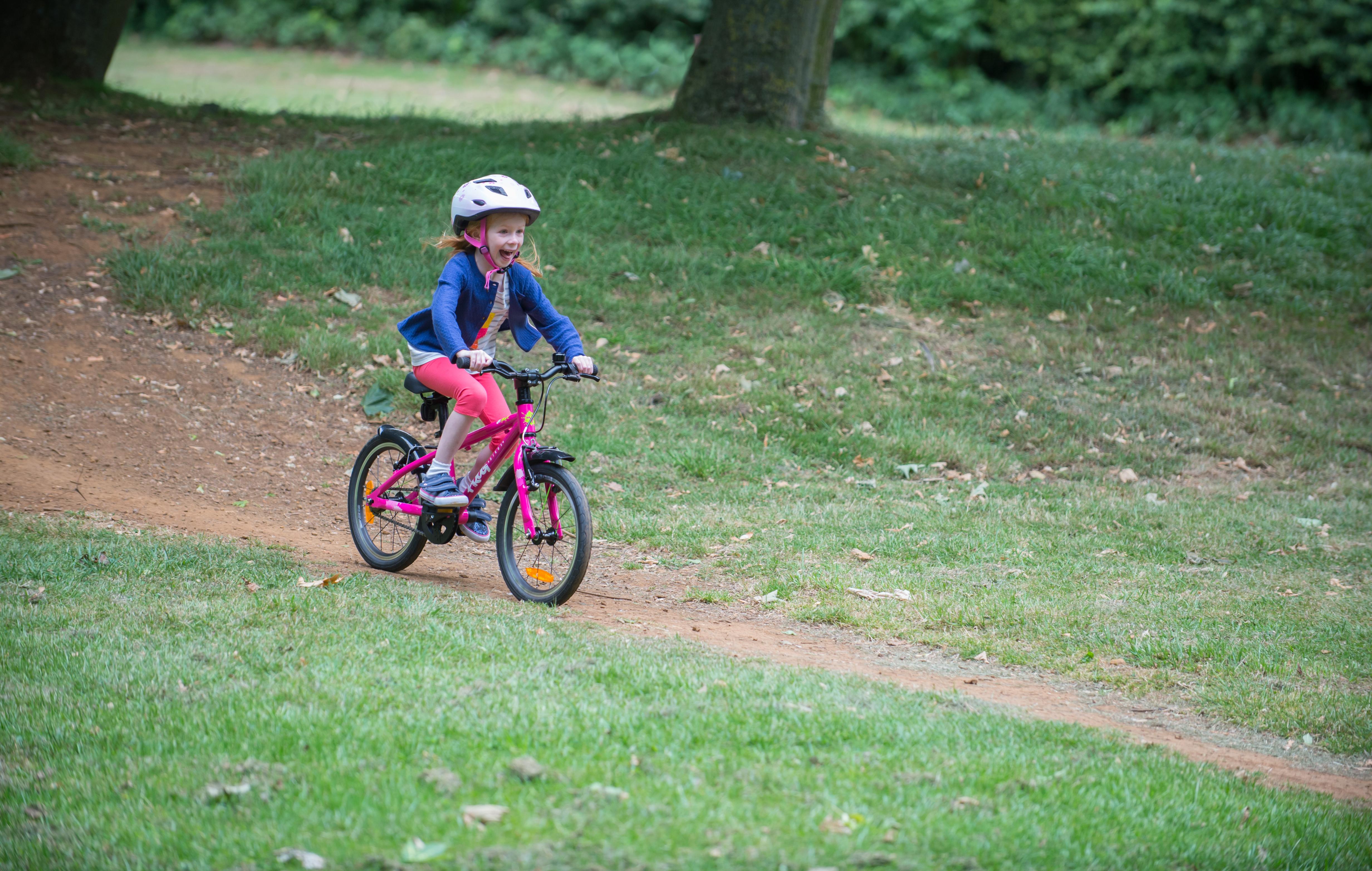 Girl riding bike downhill