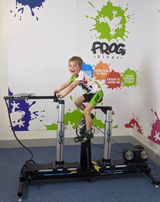 small child on the Frog Bikes scientific testing rig to find the best fitting bike geometry for a child