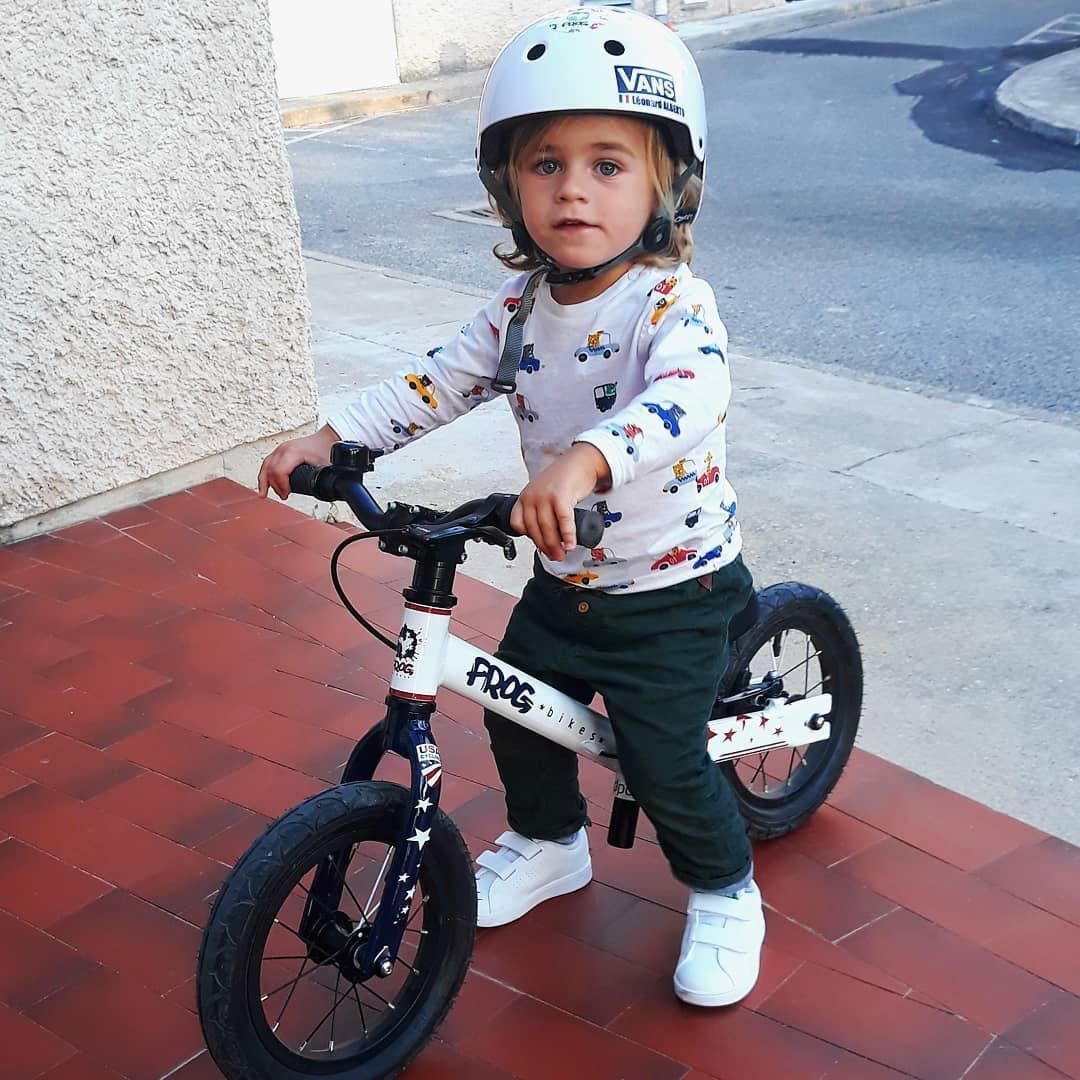Instagram @leonardonbike French Frog Bikes Ambassador Leonard sitting on a Balance Bike looking happy and comfortable