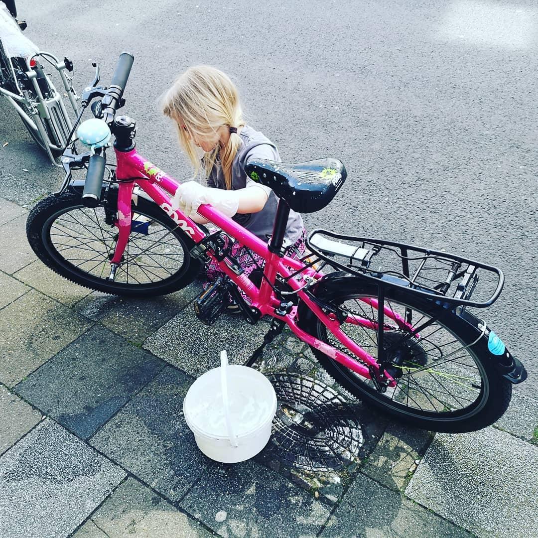 child washing their bike