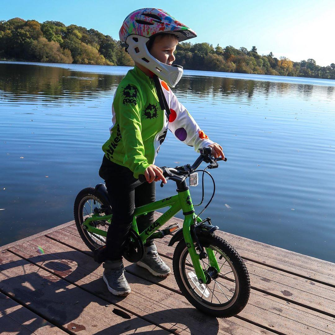 instgram @dad_life_with_the_austins child on a bike by a lake