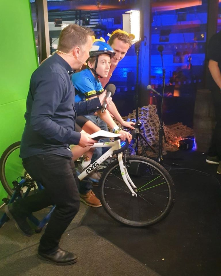 Ethan cycling on the set of the live broadcast for BBC Chidren in Need