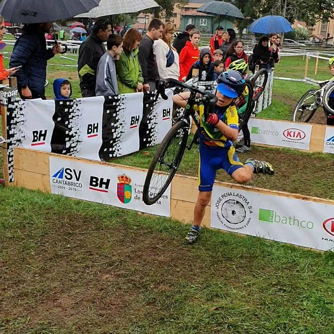 child carrying a cyclocross bike