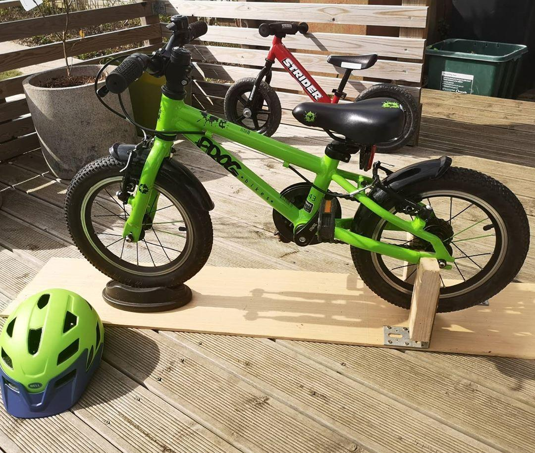 homemade wooden bike stand so that a child can cycle indoors taken by instagram @jongammdge