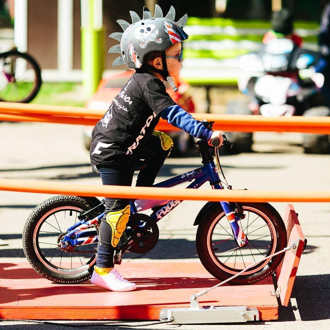 Young boy on a bike at the start of a race waiting to go with one foot at the top of his pedal ready to push off taken by instagram @minigpru