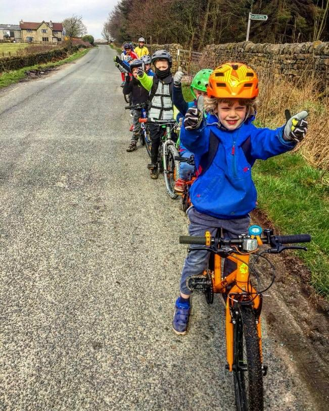 happy kids cycling in a group